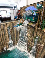 3D-Street-Art-Sprite-Man-Surfing-on-a-Waterfall-Image